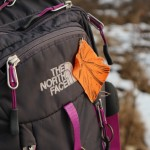 backpack with divest symbol attached