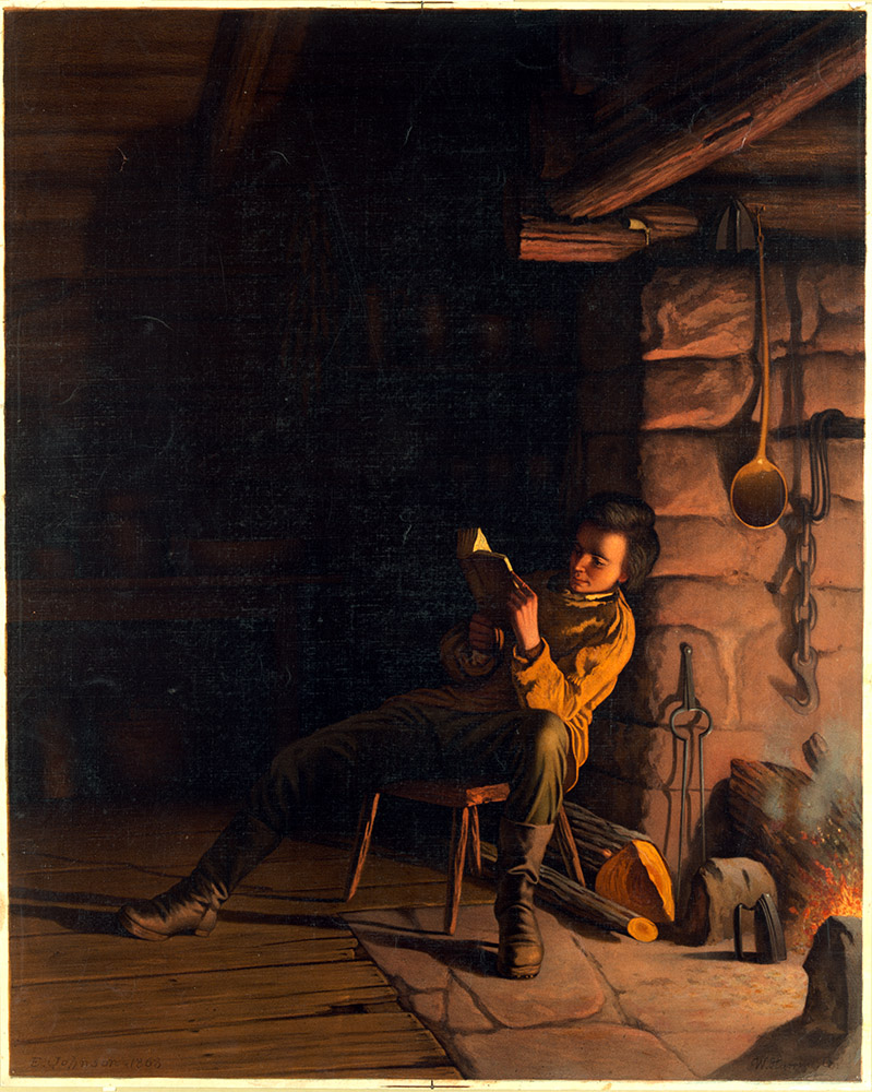 a boy reading late